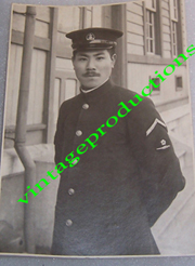 WWII Japanese Navy CPO Wearing Blue Uniform With Insignia Photo
