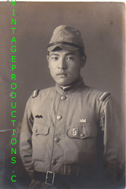 Japanese Army NCO With Squadron marking, Branch Line and a crown shaped patch over his left pocket Photo