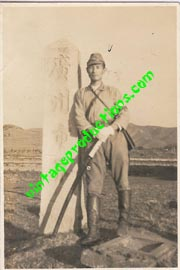 Japanese Officer Holding Samurai Sword Next To A War Monument Photo