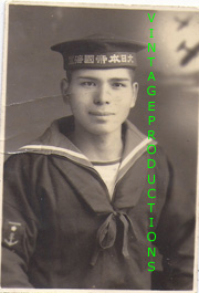 Late WWII Japanese Navy Sailor In Studio Setting With Aviation Background Photo