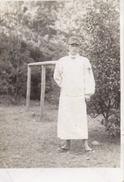 WWII Era Army Soldier Wearing Medical Robe Photo