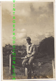 WWII Japanese Army Officer In Tropical Uniform Holding Sword Photo